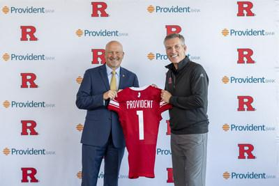 Pat Hobbs, Director of Intercollegiate Athletics, Rutgers University (Right), presents Chris Martin, Chairman, President, and CEO, Provident Bank with a Rutgers football jersey to commemorate the two organizations' partnership.