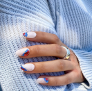 """<p>Nothing says Fourth of July like foil in red and blue. Paint your nails an off-white color and add some white glitter to make them patriotic.</p><p><a class=""""link rapid-noclick-resp"""" href=""""https://www.amazon.com/Paillette-EBANKU-Sequins-Glitter-Decoration/dp/B088KFQ6G6/?tag=syn-yahoo-20&ascsubtag=%5Bartid%7C10055.g.1278%5Bsrc%7Cyahoo-us"""" rel=""""nofollow noopener"""" target=""""_blank"""" data-ylk=""""slk:SHOP NAIL FOIL"""">SHOP NAIL FOIL</a></p>"""