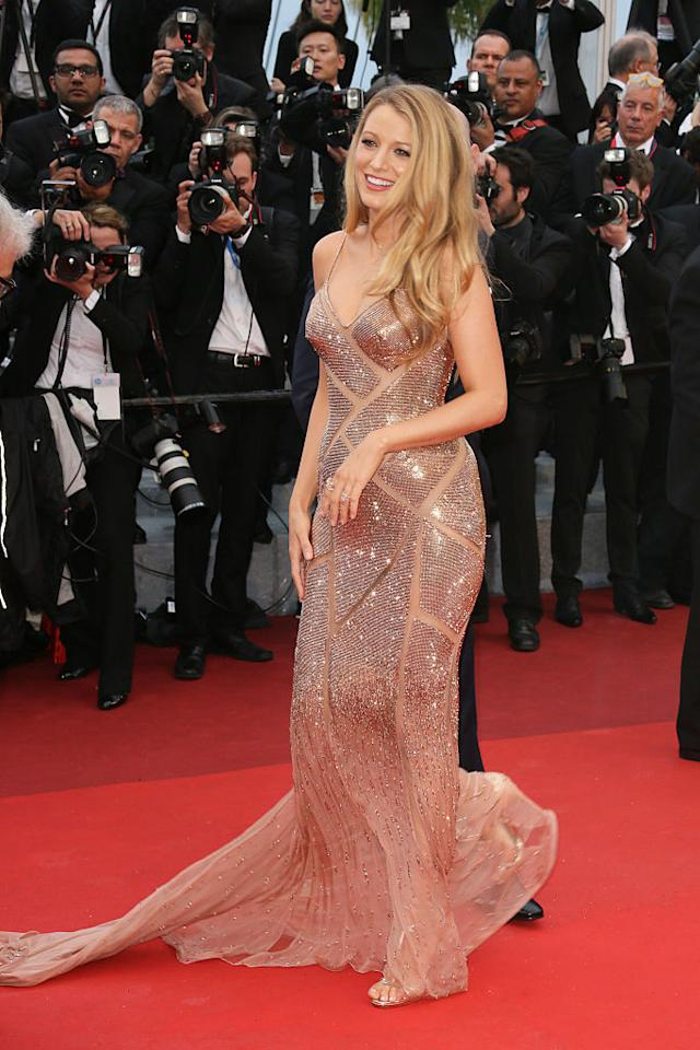 This rose gold full length dress sparkles as Blake walks down the red carpet at the 69th Cannes Film Festival.