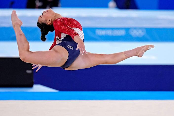 Sunisa Lee competes in the floor exercise.