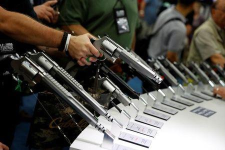 Attendees visit the trade booths during the National Rifle Association's annual meeting in Louisville, Kentucky