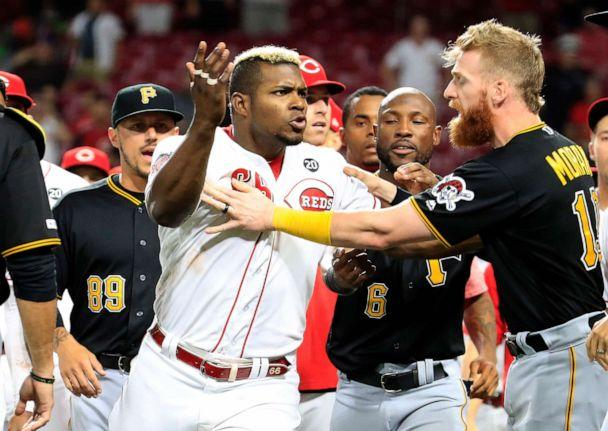 PHOTO: Yasiel Puig (No. 66) of the Cincinnati Reds is restrained during a bench clearing altercation against the Pittsburgh Pirates at Great American Ball Park on July 30, 2019 in Cincinnati. (Andy Lyons/Getty Images)