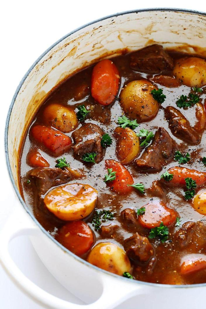 """<p>Pair this rich, delicious stew with a bottle of Guinness for the ultimate comfort meal. </p><p><em><a href=""""https://www.gimmesomeoven.com/guinness-beef-stew/"""" rel=""""nofollow noopener"""" target=""""_blank"""" data-ylk=""""slk:Get the recipe from Gimme Some Oven »"""" class=""""link rapid-noclick-resp"""">Get the recipe from Gimme Some Oven »</a></em></p><p><strong>RELATED: </strong><a href=""""https://www.goodhousekeeping.com/food-recipes/healthy/g748/healthy-soup-stew-recipe/"""" rel=""""nofollow noopener"""" target=""""_blank"""" data-ylk=""""slk:21 Healthy Soups and Stews That'll Warm You up All Winter"""" class=""""link rapid-noclick-resp"""">21 Healthy Soups and Stews That'll Warm You up All Winter</a></p>"""