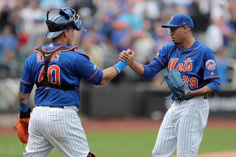 New York Mets relief pitcher Edwin Diaz, right, celebrates with catcher Wilson Ramos after defeating the Washington Nationals 6-4 during a baseball game, Thursday, May 23, 2019, in New York. (AP Photo/Julio Cortez)