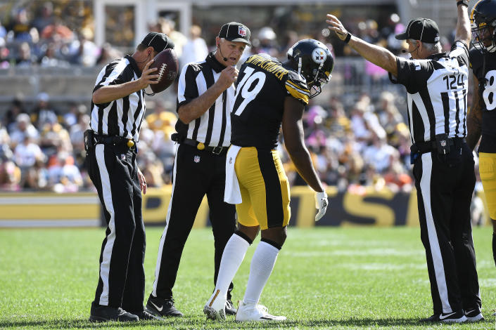 Pittsburgh Steelers wide receiver JuJu Smith-Schuster (19) gets up after being injured on a play during the first half of an NFL football game against the Denver Broncos in Pittsburgh, Sunday, Oct. 10, 2021. (AP Photo/Don Wright)