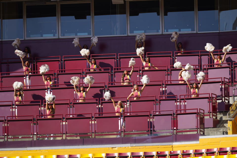 Members of the Washington Football Team cheerleading squad performing in an empty seating section at FedEx Field during the first half of an NFL football game between the New York Giants and Washington Football Team, Sunday, Nov. 8, 2020, in Landover, Md. (AP Photo/Patrick Semansky)