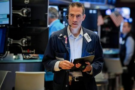 A trader works on the floor at the NYSE in New York