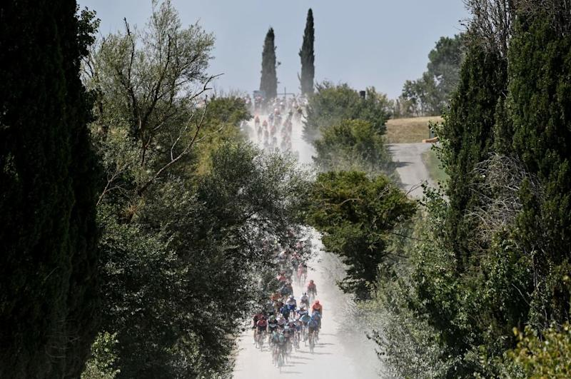 The pack rides through the countryside during the oneday classic cycling race Strade Bianche White Roads on August 1 2020 around Siena Tuscany Photo by Marco BERTORELLO AFP Photo by MARCO BERTORELLOAFP via Getty Images