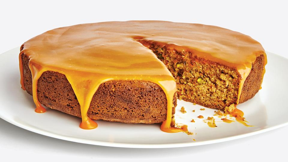 "This single-layer carrot cake is ideal for a smaller Easter gathering. Instead of the usual cream cheese frosting, it's topped with a glaze made from carrot juice and cream. <a href=""https://www.epicurious.com/recipes/food/views/cardamom-pistachio-carrot-cake?mbid=synd_yahoo_rss"" rel=""nofollow noopener"" target=""_blank"" data-ylk=""slk:See recipe."" class=""link rapid-noclick-resp"">See recipe.</a>"