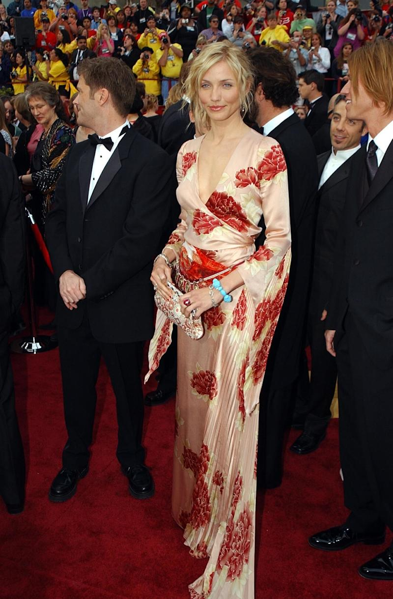 Diaz at the Academy Awards in an Emmanuel Ungaro Haute Couture kimono dress, the Duchess of Windsor's embroidered handbag from Fred Leighton, and a Fred Leighton paisley ruby, diamond, and pearl necklace sewn as a belt (2002).