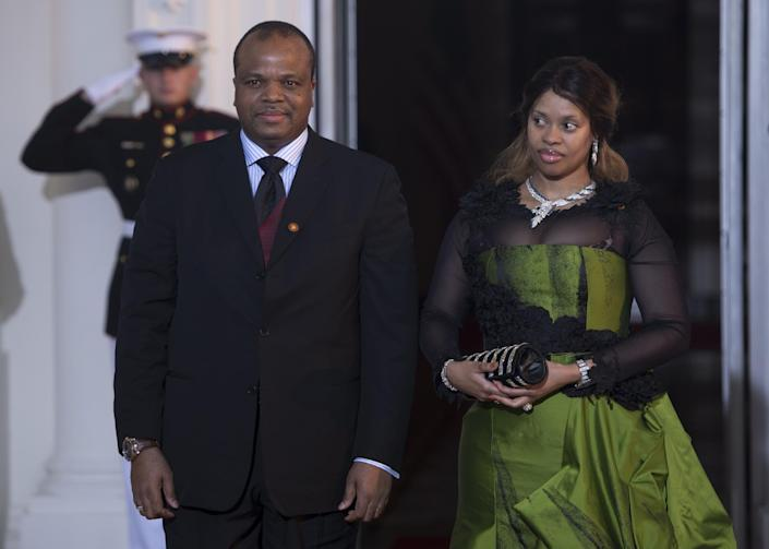 King Mswati III of Swaziland and his wife arrive at the White House during the US Africa Leaders Summit on August 5, 2014 in Washington, DC (AFP Photo/Brendan Smialowski)