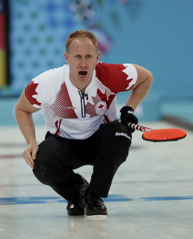 Canada's skip Brad Jacobs calls out instructions during their men's curling round robin game against Germany at the 2014 Sochi Olympics in the Ice Cube Curling Center in Sochi February 10, 2014. REUTERS/Mark Blinch (RUSSIA - Tags: OLYMPICS SPORT CURLING)