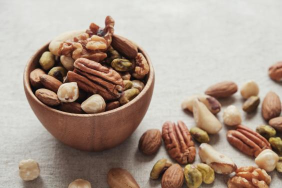 mixed nuts in wooden bowl, healthy fat and protein food and snack, ketogenic diet food (Getty Images/iStockphoto)