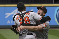 Baltimore Orioles starting pitcher John Means, right, hugs catcher Pedro Severino after Means threw a no-hitter in the team's baseball game against the Seattle Mariners, Wednesday, May 5, 2021, in Seattle. The Orioles won 6-0. (AP Photo/Ted S. Warren)