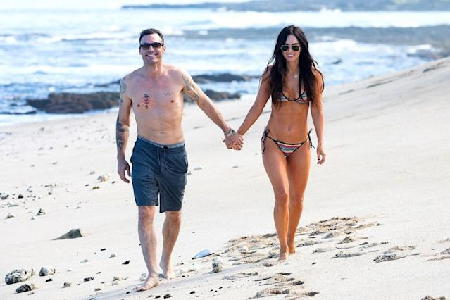 "<p>In early April, the couple took <a href=""https://www.yahoo.com/entertainment/megan-fox-brian-austin-green-not-broken-photo-shoot-hawaii-215718765.html"" data-ylk=""slk:one of their regular trips to Hawaii;outcm:mb_qualified_link;_E:mb_qualified_link"" class=""link rapid-noclick-resp newsroom-embed-article"">one of their regular trips to Hawaii</a>, where they held hands as they walked along the beach. Luckily, a photographer was there to capture their PDA and squash breakup rumors. (Photo: Backgrid) </p>"