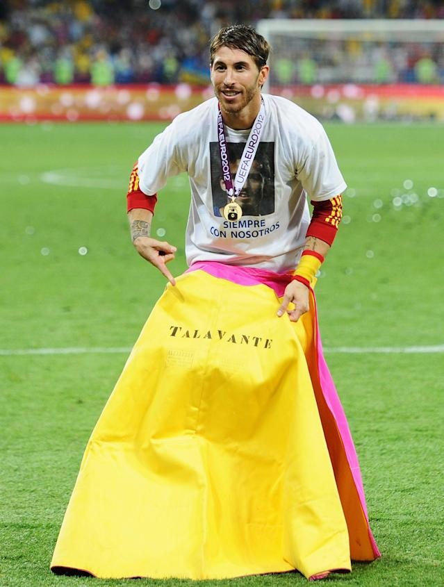 KIEV, UKRAINE - JULY 01: Sergio Ramos poses with a matador's cape displaying the name Talavante as he celebrates victory in the UEFA EURO 2012 final match between Spain and Italy at the Olympic Stadium on July 1, 2012 in Kiev, Ukraine. (Photo by Jasper Juinen/Getty Images)