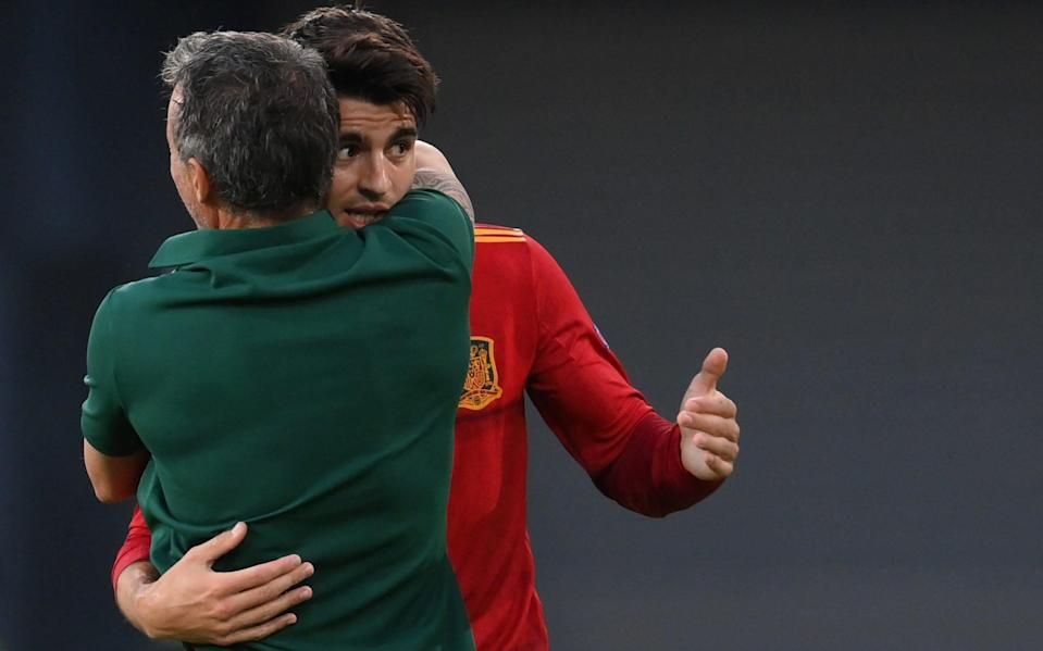 Morata embraces Spain manager Luis Enrique in the aftermath of the goal - AFP
