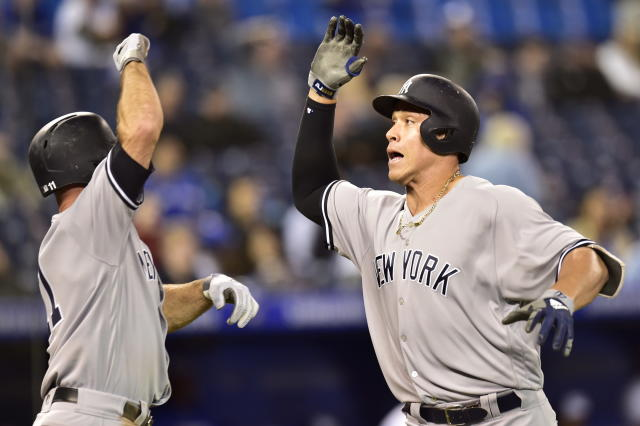 New York Yankees' Aaron Judge, right, celebrates his home run with Brett Gardner (11) against the Toronto Blue Jays during the 13th inning of a baseball game Wednesday, June 6, 2018, in Toronto. (Frank Gunn/The Canadian Press via AP)