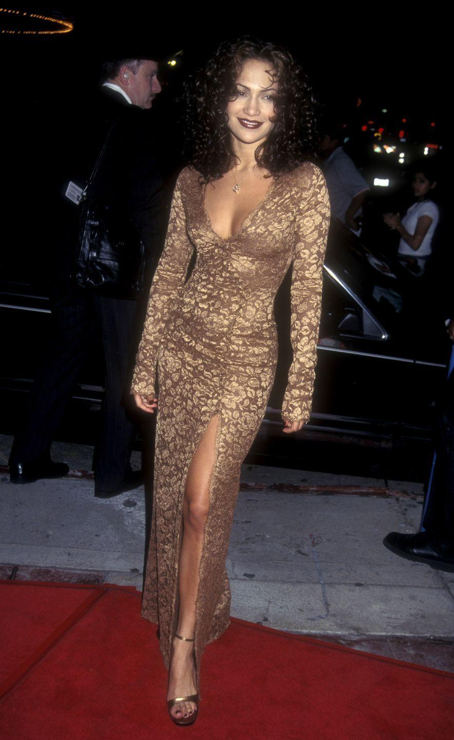 <p>Wearing a crushed velvet maxi dress at a film premiere in California. </p>