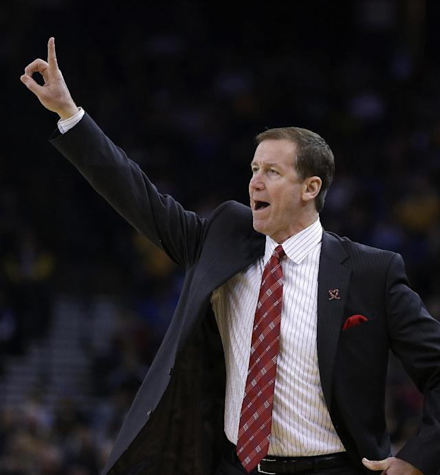 Portland Trail Blazers coach Terry Stotts gestures on the sideline during the first half of an NBA basketball game against the Golden State Warriors Saturday, Nov. 23, 2013, in Oakland, Calif. (AP Photo/Ben Margot)