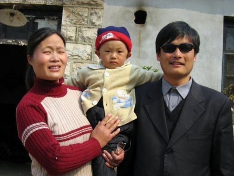 This undated photo provided by the China Aid Association shows blind Chinese legal activist Chen Guangcheng, right, with his son, Chen Kerui, with his wife Yuan Weijing, left, in Shandong province, China. Chen, a blind activist said Wednesday, May 2, 2012, that U.S. officials told him that Chinese authorities would have beaten his wife to death had he not left the American Embassy, where he sought sanctuary after fleeing persecution by local officials in his rural town. A senior U.S. official, speaking on condition of anonymity because of the sensitivity of the issue, denied that the administration had passed on to Chen Guangcheng any threat of violence to his family, but did say that Chen was told that if he stayed in the embassy indefinitely, his family would be returned to their home province. (AP Photo/www.ChinaAid.org)