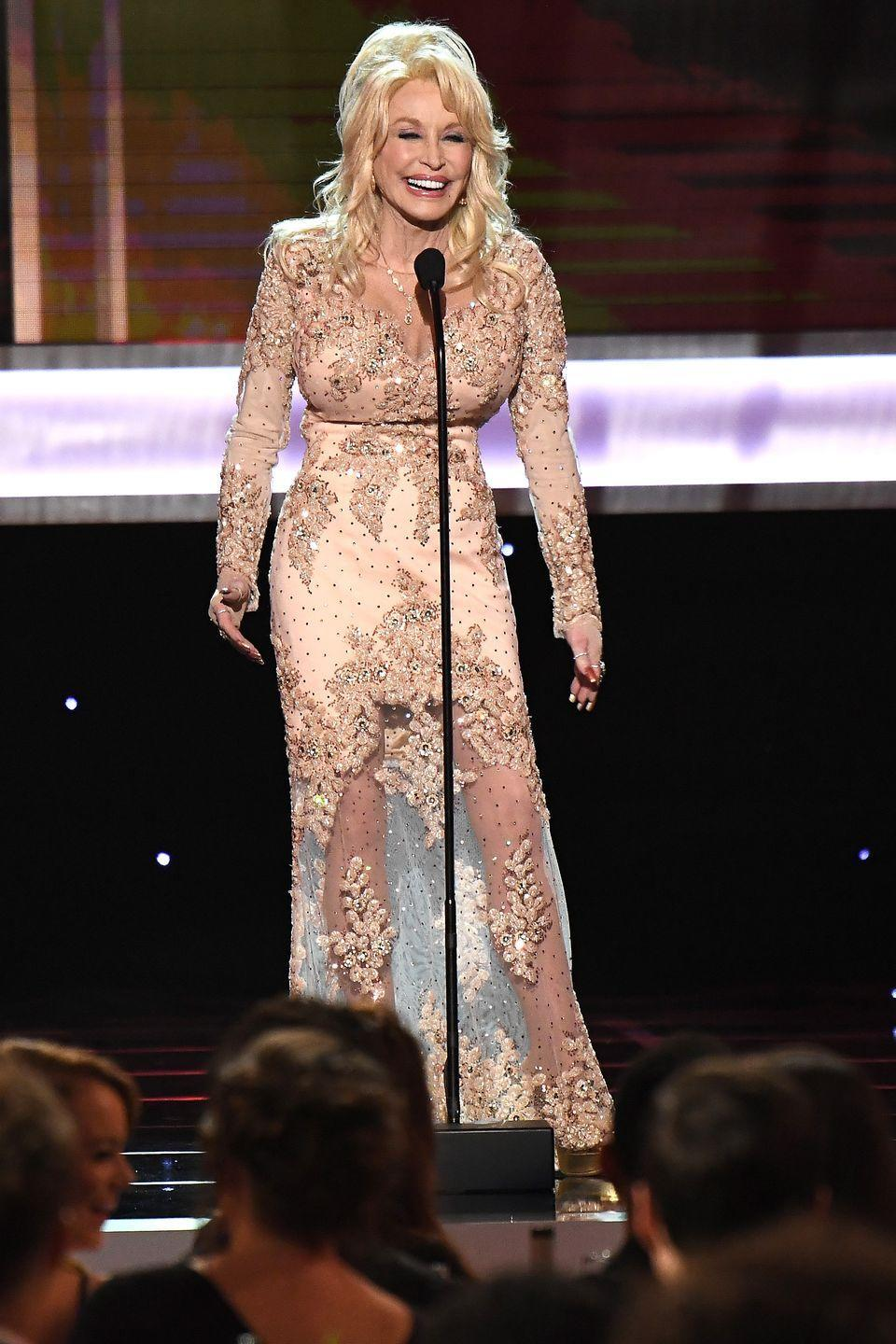 <p>Dolly delights the audience at the 23rd Screen Actors Guild Awards in 2017. Here, country glamour is perfected with this beaded, lacy ensemble in a peachy-keen hue. </p>