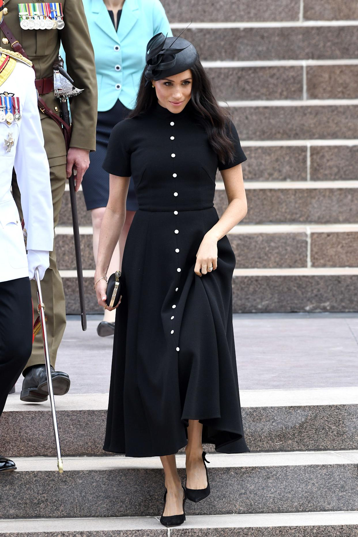 The duchess wears a black dress by Emilia Wickstead at the Anzac Memorial at Hyde Park in Sydney on Oct. 20, day five of the royal tour.