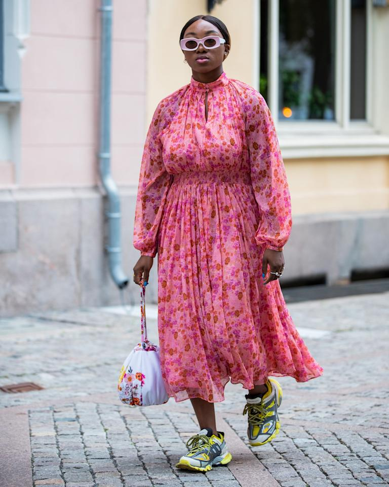 Pretty, bud-covered dresses and sneakers are pretty standard summer attire. Pick a mid-length, long-sleeved style to take the combo confidently into the next season, too.
