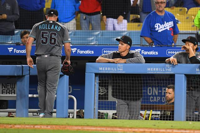 Closer Greg Holland walked four straight batters and gave away the Diamondbacks' lead in the bottom of the ninth against the Dodgers, which is not what a closer is supposed to do. (Getty Images)
