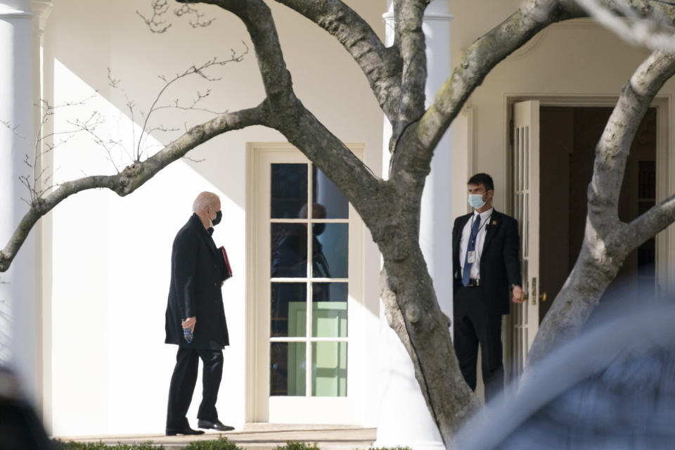 President Joe Biden walks to the Oval Office after traveling to Georgetown University to receive ashes for Ash Wednesday, Wednesday, Feb. 17, 2021, in Washington. (AP Photo/Evan Vucci)