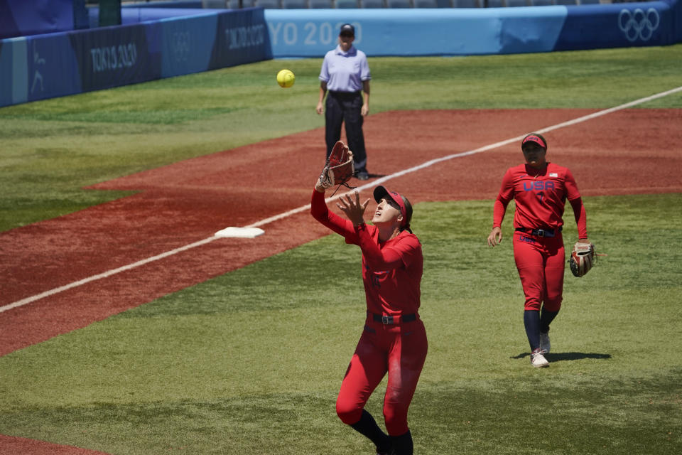 United States' Monica Abbott (14) catches a pop up hit by Australia's Leah Parry for an out in the fifth inning of a softball game at the 2020 Summer Olympics, Sunday, July 25, 2021, in Yokohama, Japan. (AP Photo/Sue Ogrocki)