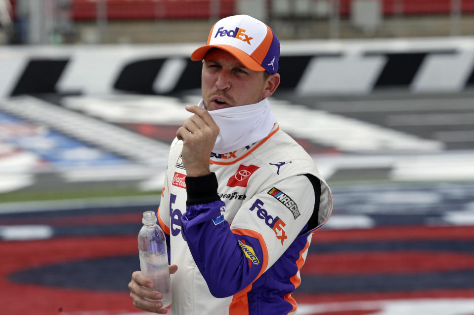 FILE - In this May 24, 2020, file photo, driver Denny Hamlin waits to qualify prior to the NASCAR Cup Series auto race at Charlotte Motor Speedway in Concord, N.C. Hamlin is 0-for-3 in championship chances, his shot at an elusive first NASCAR crown ending just short of the finish line all three times he's been close. It's his turn again, without rival Kevin Harvick in his way in Sunday's season finale at Phoenix Raceway. (AP Photo/Gerry Broome, File)