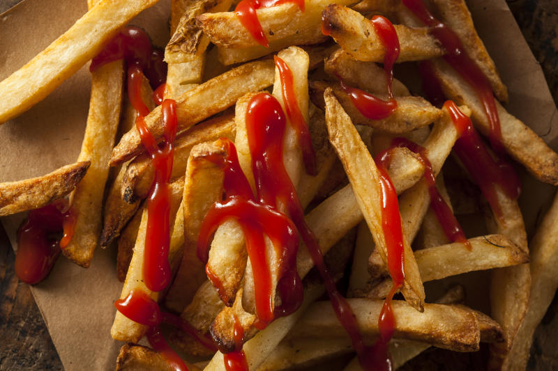 Homemade French Fries Covered in Tomato Ketchup