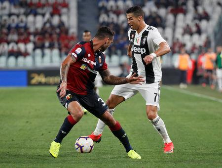 Soccer Football - Serie A - Juventus v Genoa - Allianz Stadium, Turin, Italy - October 20, 2018  Juventus' Cristiano Ronaldo in action with Genoa's Pedro Pereira   REUTERS/Stefano Rellandini