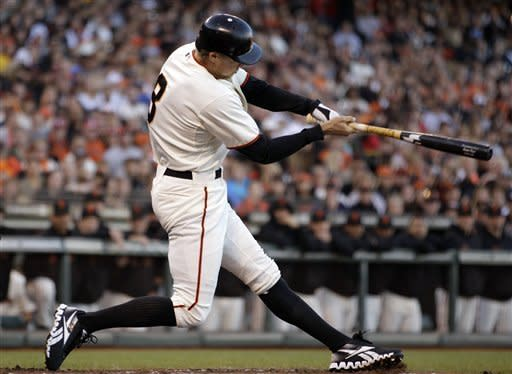 San Francisco Giants' Hunter Pence swings for an RBI sacrifice fly off San Diego Padres' Andrew Werner in the first inning of a baseball game, Saturday, Sept 22, 2012, in San Francisco. (AP Photo/Ben Margot)