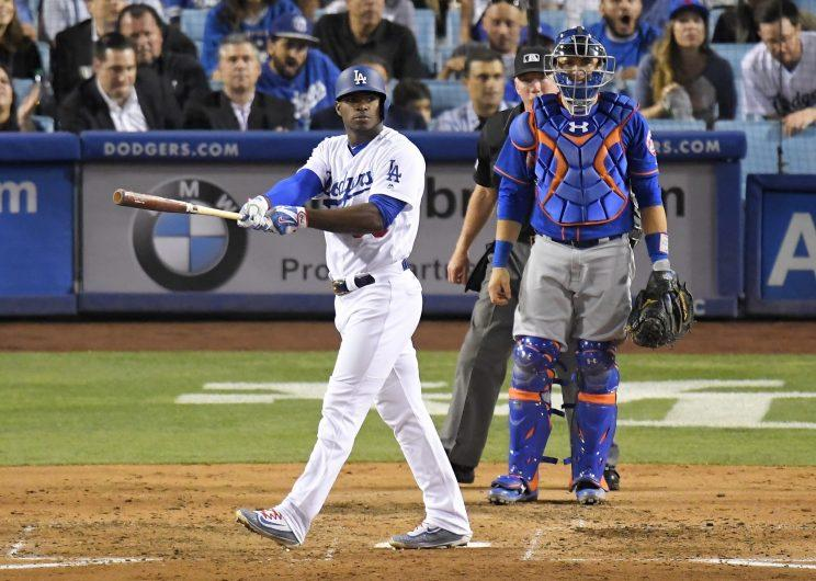 Yasiel Puig admiring his fourth-inning homer. (AP)