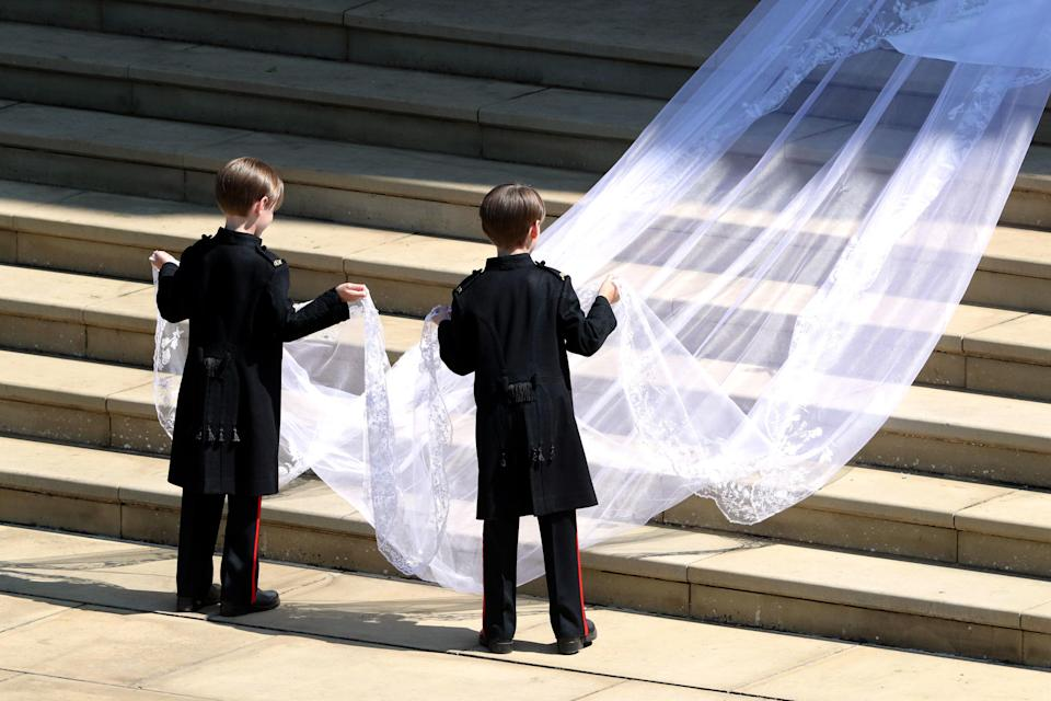 <p>Meghan Markle brought a touch of Hollywood glamour to her look in a draping veil, which is metres longer than her train. ANDREW MATTHEWS/AFP/Getty Images </p>