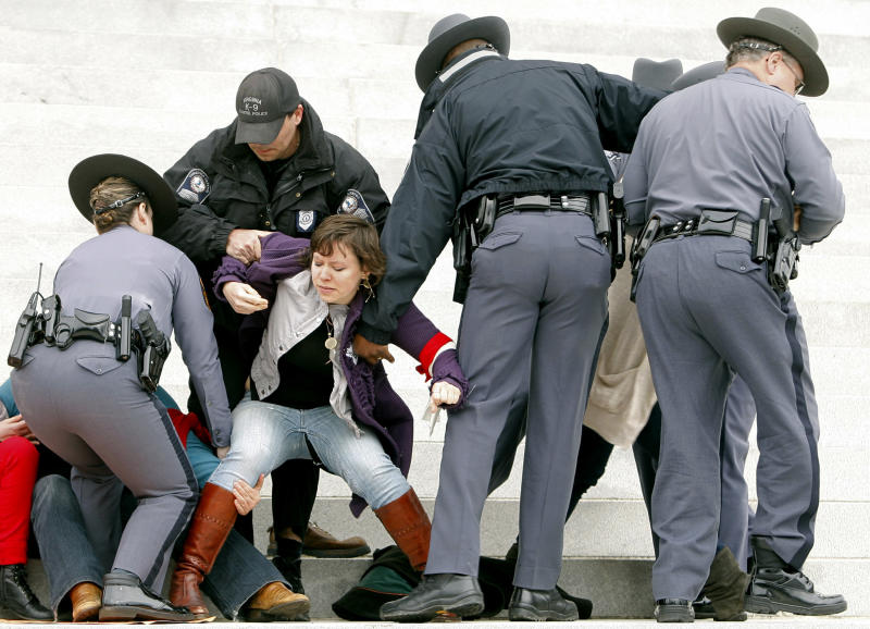 FILE - In this Saturday, March 3, 2012 file photo, police remove women's rights activists from the front steps of the state capitol in Richmond, Va., during a protest against legislation that requires an ultrasound before an abortion. Gov. Bob McDonnell signed the bill into law later in the year. (AP Photo/Richmond Times-Dispatch, Eva Russo, File)