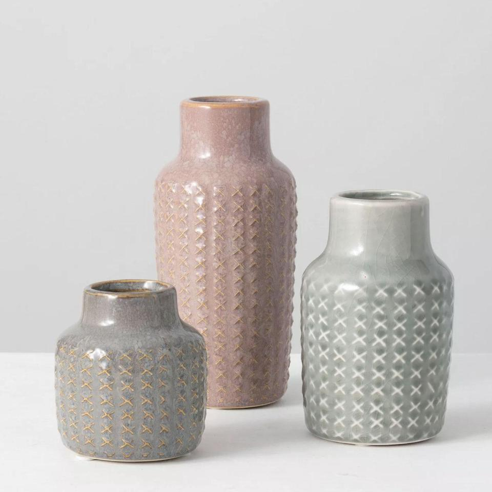 """Don't sleep on good ol' Targét for pottery, either. These neutral textured vases come in a trio that rings in at under $30, along with cute dishes that are perfect for any small succulents on your windowsill. $26, Target. <a href=""""https://www.target.com/p/sullivans-set-of-3-patterned-vase-7-25-h-5-5-h-3-75-h-multicolored/-/A-79913986#lnk=sametab"""" rel=""""nofollow noopener"""" target=""""_blank"""" data-ylk=""""slk:Get it now!"""" class=""""link rapid-noclick-resp"""">Get it now!</a>"""