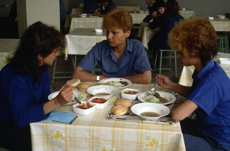 Women prisoners eating a prison canteen (Photo: Liba Taylor via Getty Images)