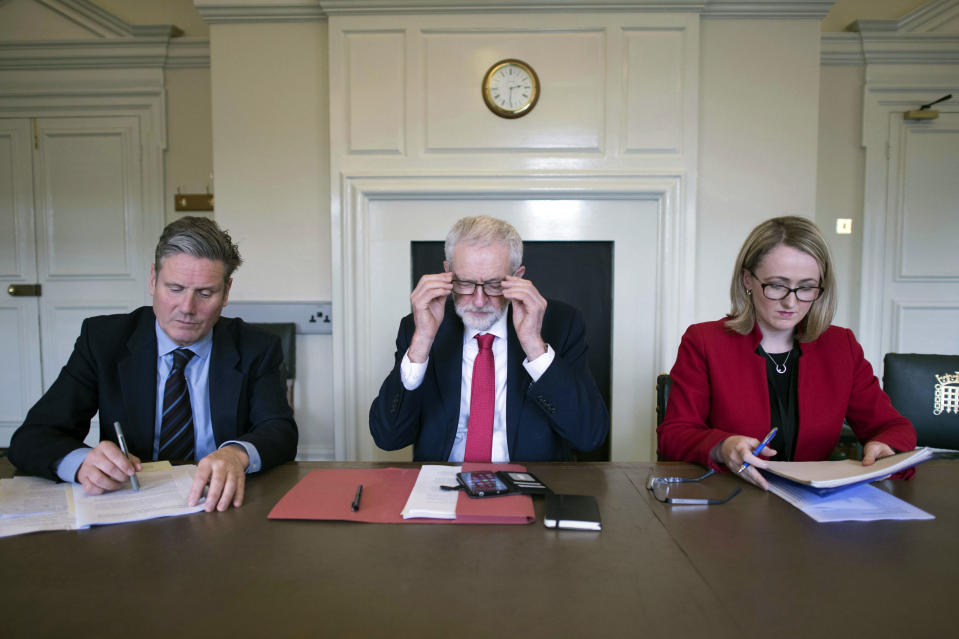 Labour leader Jeremy Corbyn, centre, shadow Brexit secretary Keir Starmer, left and shadow business secretary Rebecca Long-Bailey prepare in his office at the Houses of Parliament in London. Wednesday April 3, 2019,  ahead of a meeting with Britain's Prime Minister Theresa May for talks on ending the impasse over the country's departure from the European Union — a surprise about-face that left pro-Brexit members of May's Conservative Party howling with outrage. (Stefan Rousseau/PA via AP)