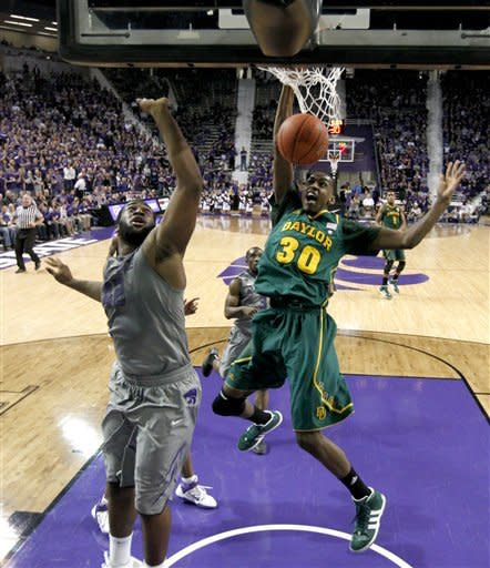 Baylor forward Quincy Miller (30) gets past Kansas State forward Thomas Gipson (42) to put up a shot during the first half of an NCAA college basketball game, Tuesday, Jan. 10, 2012, in Manhattan, Kan. (AP Photo/Charlie Riedel)
