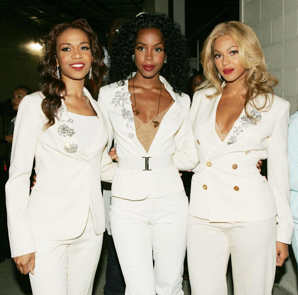 <p>Looking sleek in white suits at the NFL Opening Kickoff in 2004.</p>