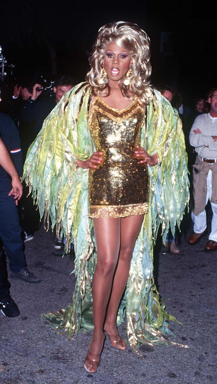<p>Another gold dress, but if something works, why change it? Plus, this mermaid-seaweed coat is an unforgettable touch. </p>