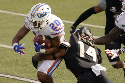 Florida running back Malik Davis (20) is hit by Vanderbilt safety Maxwell Worship (14) in the second half of an NCAA college football game Saturday, Nov. 21, 2020, in Nashville, Tenn. (AP Photo/Mark Humphrey)