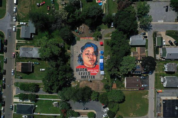 PHOTO: A large-scale ground mural depicting Breonna Taylor with the text 'Black Lives Matter' is painted at Chambers Park, July 5, 2020, in Annapolis, Md. (Patrick Smith/Getty Images)