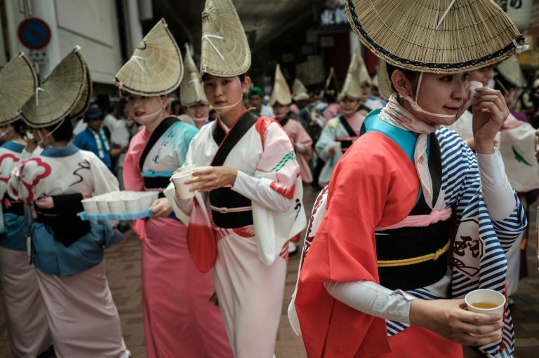 Performers prepare for the Awa Odori festival, which attracts more than 1.2 million people annually