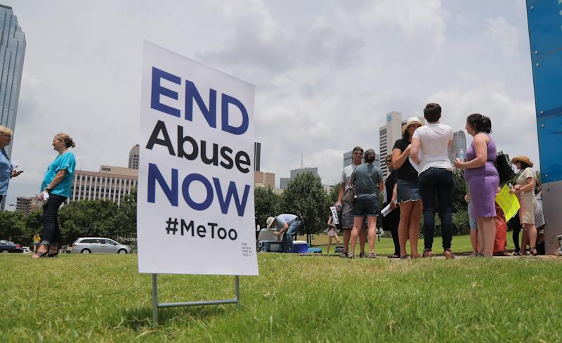 A small group of protesters fighting various forms of abuse within the church engage passersby outside at the Southern Baptist Convention meeting on Tuesday, June 12, 2018 in Dallas, Texas.  (Fort Worth Star-Telegram via Getty Images)