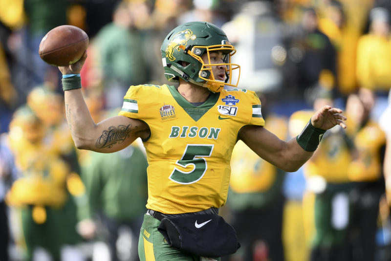 Trey Lance of the North Dakota State Bison looks to pass the ball against James Madison during the Division I FCS Football Championship on Jan. 11, 2020. (Justin Tafoya/NCAA Photos via Getty Images)