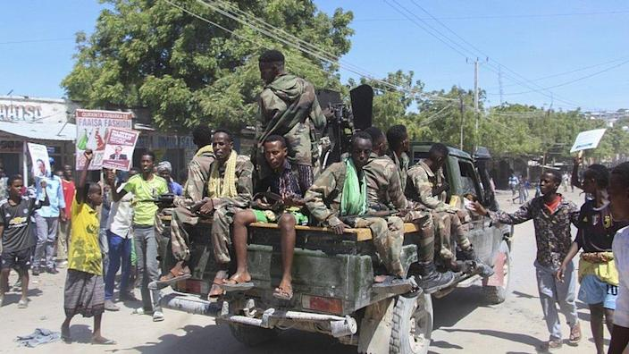 Protesters against the Somali president cheer Somali soldiers loyal to a break away military faction in the streets of Fagah cross in northern Mogadishu, Somalia, 25 April 2021